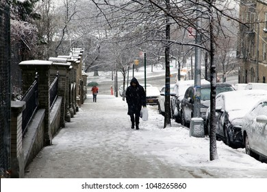 BRONX, NEW YORK - MARCH 7: Man walks up hill during fall in the Bronx New York.  Taken March 7, 2018 in New York.