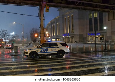 BRONX, NEW YORK - MARCH 7: Police vehicle parked near Yankee Stadium during snow sleet conditions.  Taken March 7, 2018 in New York.