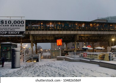 BRONX, NEW YORK - MARCH 7: Street near Yankee Stadium subway station during snow storm.  Taken March 7, 2018 in New York.