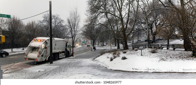 BRONX, NEW YORK - MARCH 7: Wide view of Macombs park and sanitation truck during snow storm.  Taken March 7, 2018 in New York.