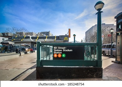 BRONX, NEW YORK - MARCH 8, 2014:  Street view of New York City train entrance at Yankee Stadium.  There are 468 in the NYC transit system.
