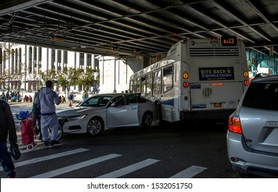 BRONX, NEW YORK/USA - October 13, 2019: MTA bus rear ends an automobile on intersection of River avenue near Yankee Stadium.