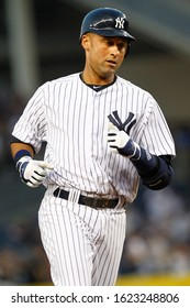 BRONX, NY - APR 16: New York Yankees shortstop Derek Jeter (2) rounds the bases after hitting a solo homerun during the first inning against the Minnesota Twins on April 16, 2012 at Yankee Stadium.