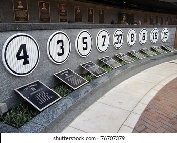 BRONX, NY - APRIL 13: View of part of the retired numbers of Yankee greats in Monument Park shown on April 13, 2011 in Yankees Stadium in the Bronx, NY.