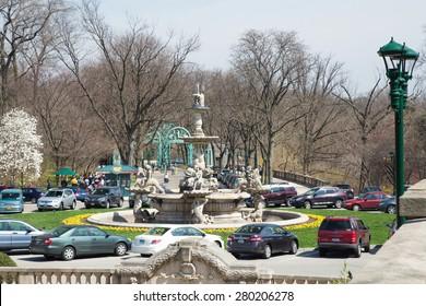 BRONX, NY - APRIL 14, 2014:  Traffic circle and landmark fountain at historic Bronx Zoo