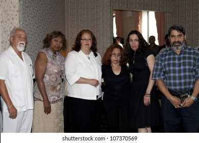 BRONX, NY - JULY 4: From right to left, Gilberto Pulpo Colon, grandaughter of Yomo, daughter, wife, Malin Falu and friend attend cuatro player Yomo Toro's funeral.  Photographed July 4, 2012 in NYC.