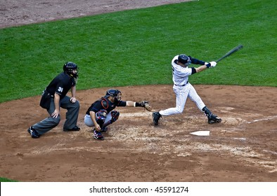 BRONX, NY - JUNE 13: Derek Jeter, the Yankee hit leader. Head down, full extension - a classic swing in a game vs. the Mets on June 13, 2009 in Bronx, NY. The Yankees became World Series Champions.