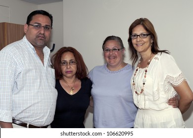 BRONX, NY - JUNE 24: Mayor Guanica, Puerto Rico, daughter of cuatro player Yomo Toro, wife and Marlyn Velazquez visit Yomo at hospital while his health was failing. Photographed June 24, 2012 in NYC.