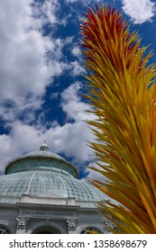 Bronx, NY - May 14 2017: Dale Chihuly's Scarlet and Yellow Icicle Tower on display at the New York Botanical Garden