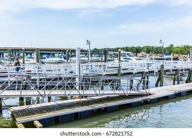 Bronx, NY USA - June 11, 2017: City Island harbor with boats and reflection