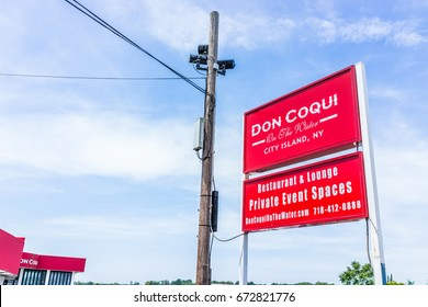 Bronx, NY USA - June 11, 2017: Restaurant sign in City Island called Don Coqui on the water waterfront