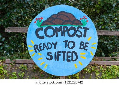 """Bronx, NY/USA- August 17, 2014: A hand-painted wood sign in one of the Bronx Botanical Garden's educational gardens reads """"COMPOST READY TO BE SIFTED."""""""