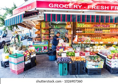Bronx, USA - October 28, 2017: Cheap fruit vegetable stand food display market shop sale display in Fordham Heights center, New York City, NYC, grocery sign