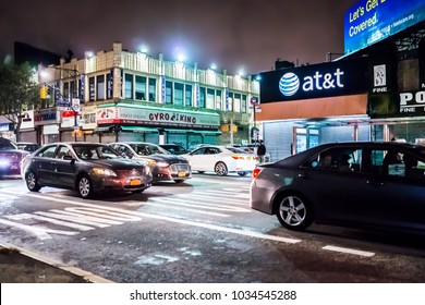 Bronx, USA - October 28, 2017: Road street in Fordham Heights center with cars traffic, New York City, NYC in evening night, gyro king food, att sign