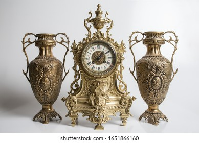 bronze amphorae and clock on a white background, antique vases and clock studio photo, antique clock and two antique vessels,
