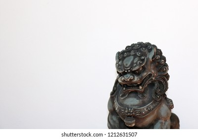 Bronze Asian Lion Statue isolated on white background
