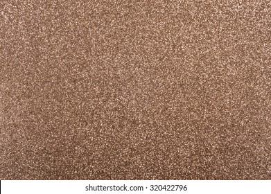 Bronze background with metallic glitter texture in full frame