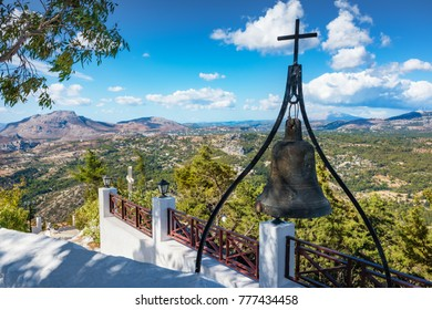 Bronze bell with cross on wall of Tsambika Monastery, (RHODES, GREECE)