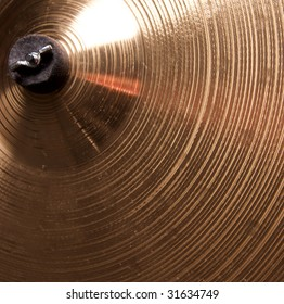 A bronze brass cymbal close up in the square format.