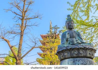 bronze buddha statue at senso-ji temple, asakusa, tokyo, japan