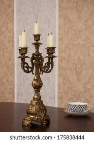 Bronze candlestick on the oak table