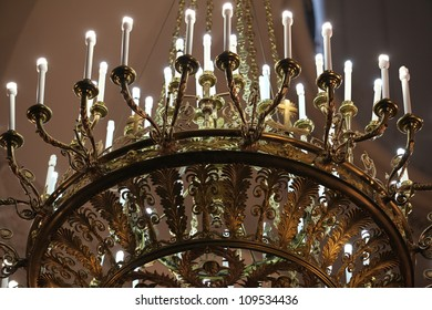 Bronze chandelier of the  Antiques palace interiors, close-up