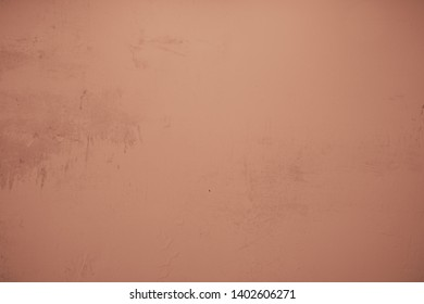 Bronze concrete wall with randomly plastered structures and light soiling in industrial design. Pastel colored stone wall as background and design element for art. Bright dark gradients.