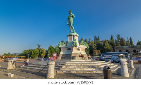 Bronze copy of the statue of David by Michelangelo at Piazzale Michelangelo in Florence. Blue sky at summer day. People walking around