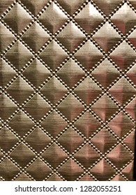 Bronze door diamond pattern background