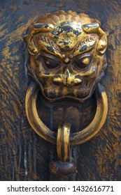 Bronze door knocker of animal head of qilin in Beijing