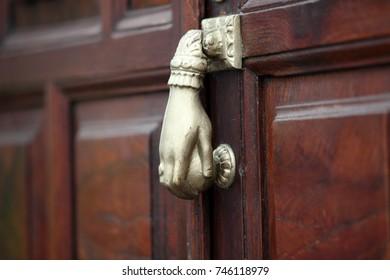 bronze door knocker in a form of a hand