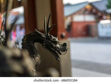 bronze dragon statues in sensoji temple in tokyo, japan