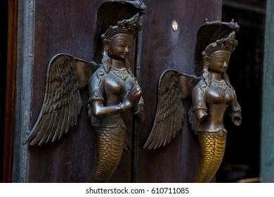 bronze female sculpture door-handle