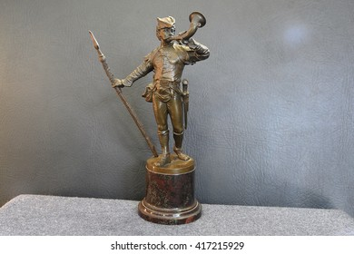 bronze figure of a man
