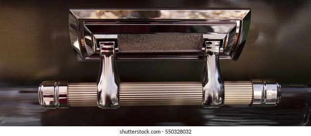Bronze handle of casket.
