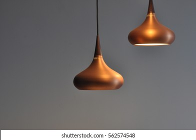 Bronze hanging dining lights combination with cool grey background