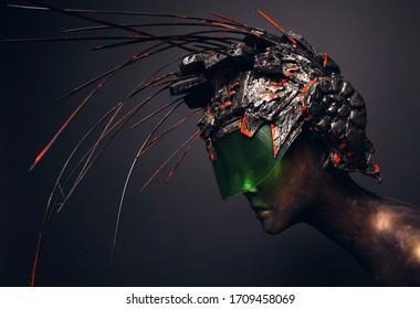 Bronze head of mannequin in decorated bronze helmet, dark studio background