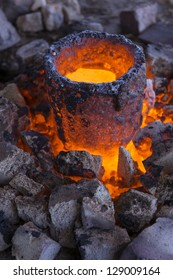 Bronze is heated into a molten state prior to casting
