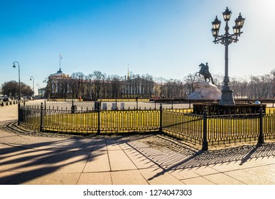 Bronze Horseman is equestrian statue of Peter Great in  Senate Square, Admiralty building and street lamp with shadow in Saint Petersburg, Russia.
