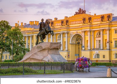 "The Bronze Horseman - statue of Peter the Great in Saint Petersburg, Russia. Text on the stone: ""Catherine the Second to Peter the First, 1782"". Constitutional Court in the morning. St. Petersburg."