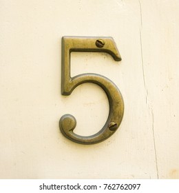 Bronze house number five (5)