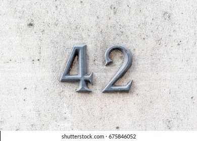 bronze house number forty two (42).