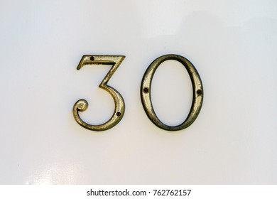 bronze house number thirty (30)