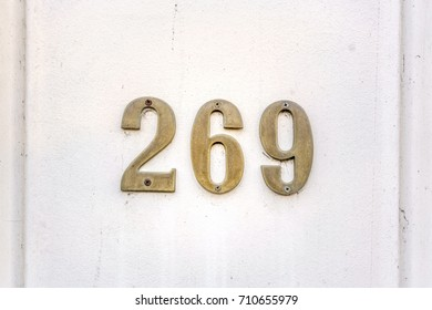 bronze house number two hundred and sixty nine (269)
