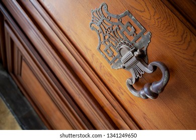 Bronze knocker on a wooden door