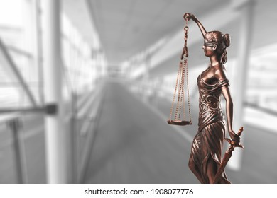 Bronze lady with scale, symbol of justice and law