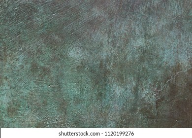 Bronze metal with green tarnished and weathered surface