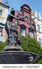 bronze monument Tryton fountain in Gdansk Poland monument on the market tourist attraction famous, travel, visit, pigeon on his head bird