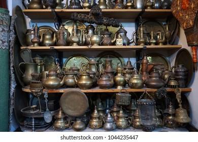 Bronze pots on the shelf in souvenir shop