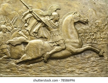 Bronze relief depicting Alexander the Great and his army in battle.
